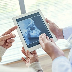 Dentists reviewing digital dental x-rays